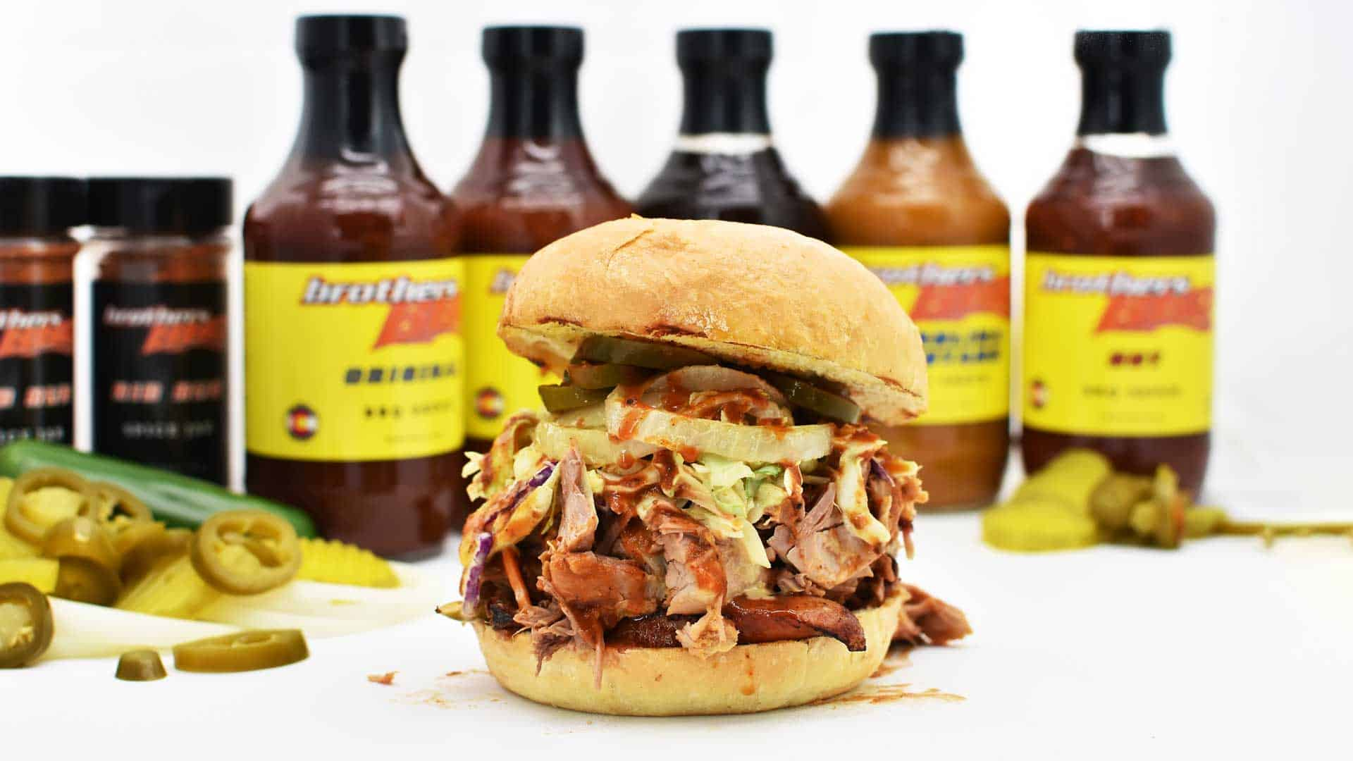 bbq sandwich with toppings and sauces Brothers BBQ Colorado