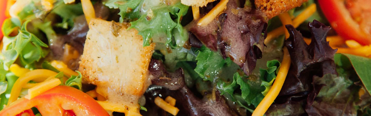 close up of salad greens and crouton from Brothers BBQ Colorado