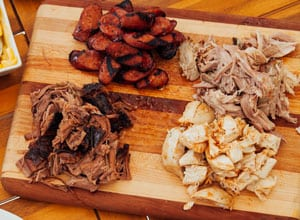 sample plate of various mats on cutting board Brothers BBQ Colorado