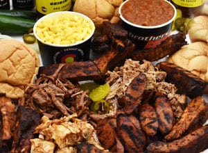 display of party plate with meats, tofu, breads and sides Brothers BBQ Colorado