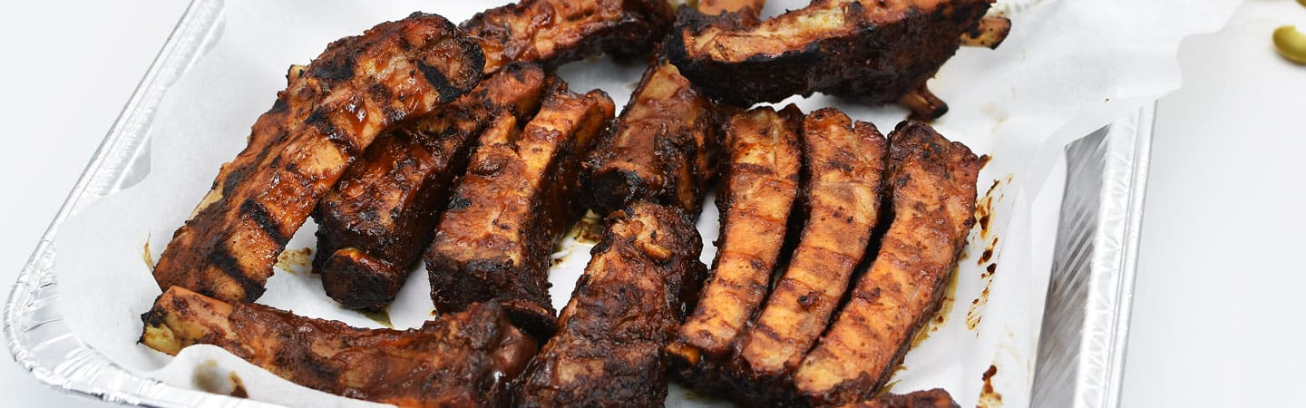 close up of bbq ribs on a plate Brothers BBQ Colorado