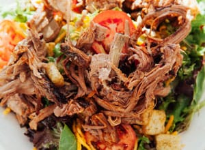 southern salad has greens and meat Brothers BBQ Colorado