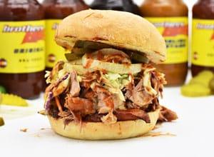bbq sandwich with slaw is popular menu item at Brothers BBQ Colorado