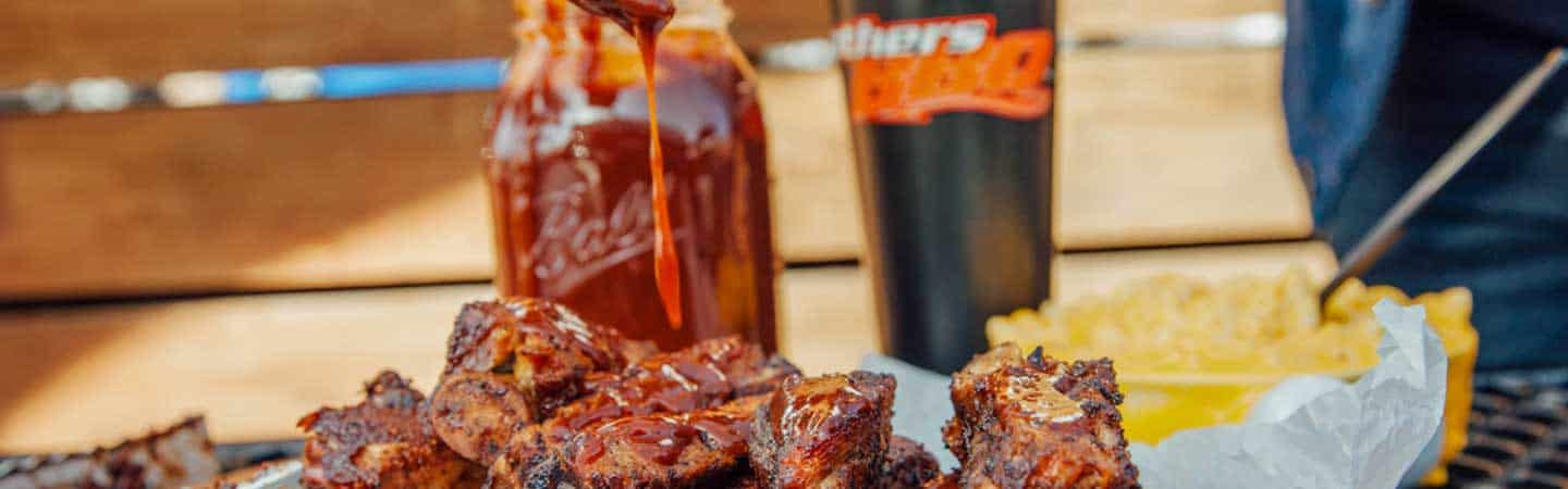 brothers-secret-sauce-dripping on meat Brothers BBQ Colorado