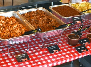 catering with various meats and sides at an outdoor event Brothers BBQ Colorado